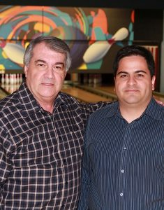 """EVERYTHING YOU GIVE WILL COME BACK TO YOU DOUBLE"" Paulo Teixeira of Strikes & Spares Entertainment Center, the Small Business of the Year, pictured with his son, Mario."