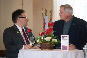 """ALL ABOUT THE ENVIRONMENT"" Honoree Geof Benson, executive director of the Dunes Learning Center, speaks with Jim Jessup, facilitator with Leadership LaPorte County."