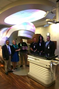 St. Mary Medical Center recently unveiled the new TrueBeam radiotherapy system to treat cancer patients. Pictured L-R: Radiation oncologist, Koppolu Sarma, MD; hospital CEO, Janice Ryba; Albert Castro, Radiation Therapist; Christpher Tien, Physicist; Biljana Terzioski, Radiation Therapist; and Pete Dyba, director of Imaging Services.