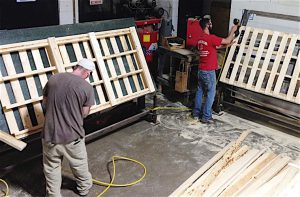 NOTHING GOES TO WASTE The company builds new pallets and repairs old ones. Any materials that aren't used to create a pallet are recycled.