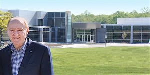 """""""THERE'S A SYNERGY"""" Jim Dworkin, retired chancellor of Purdue North Central, says a skilled workforce attracts new business investment. Still on the faculty, he is shown in front of the new James B. Dworkin Student Services and Activities Complex."""