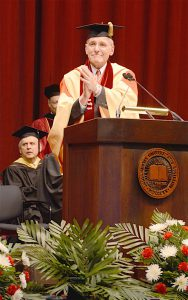 """FULLY ENGAGED CITIZENS"" Indiana University Northwest Chancellor William J. Lowe addresses the Class of 2016 at the 50th Annual Commencement Ceremony this past May."
