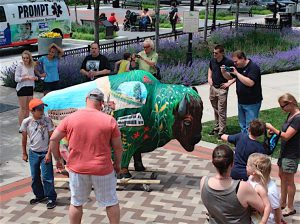 ARTISTIC CELEBRATION The Bison-tennial Public Art initiative features life-size fiberglass bison, decorated by local artists. Shown here are displays in Valparaiso and Portage.
