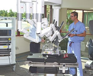 """BETTER FOR THE PATIENT"" Eric Woo, DO, of Franciscan St. Anthony Health, says surgeons using robotic technology can handle difficult cases that previously couldn't be done with small incisions."