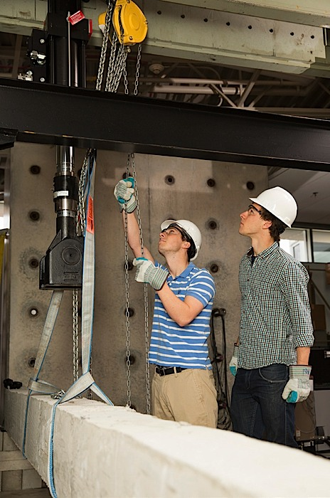 Valparaiso University juniors Adam Jerry and Matt West perform a loadbearing test in the materials engineering laboratory.
