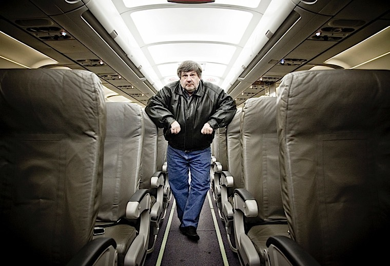 HIGH-FLYING PHILANTHROPY Nick Popovich, inside a donated plane.