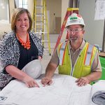 BUILDING A CAREER Ashley Dickinson, Porter Health Care System's chief operating officer, meets with Walsh Construction project superintendent Dan Prochno at the site of Porter's new emergency room in Valparaiso. The new ER is set to open in the early fall.