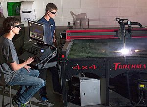 BEST UNIVERSITY FOR OBTAINING A TECHNOLOGY DEGREE Purdue University Northwest. Pictured here are technology students at the Calumet Campus in Hammond using an advanced-manufacturing plasma torch to produce parts for an off-road vehicle.
