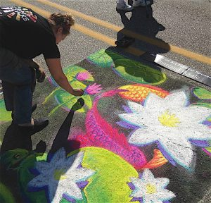 HOOKED ON ART FESTIVAL Chalk artists and others fill the streets of downtown Chesterton with color and unique creations.