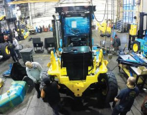 Workers assemble a new Hoist Lift Truck in East Chicago. Moving to Indiana from Illinois saved the company $1 million annually in workers' compensation-related costs according to Hoist CEO, Marty Flaska.
