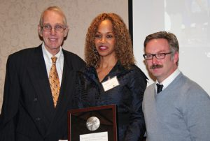 Dr. Danita Johnson Hughes, CEO of Edgewater Behavioral Health Services, accepts an award from The Society of Innovators of Northwest Indiana. Her ultimate goal as CEO is to help make a positive and measurable impact on the region.