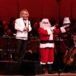 Maestro Kirk Muspratt celebrates the Symphony's 75th birthday with Santa.